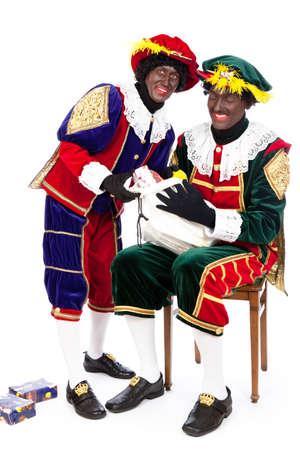 nicolaas: zwarte pieten   typical Dutch character part of a traditional event celebrating the birthday of Sinterklaas in december