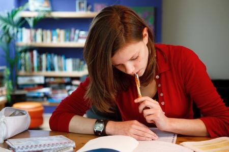 homework student: young female student doing her homework