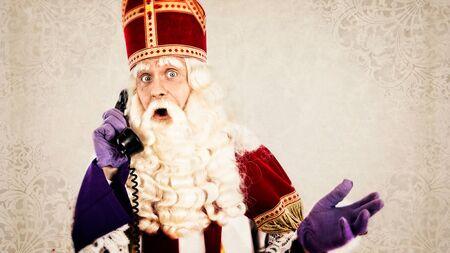 sinterklaas: Sinterklaas with old vintage telephone   Dutch character of Santa Claus Stock Photo
