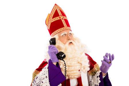 saint nicolaas: Sinterklaas with old vintage telephone  isolated  Stock Photo