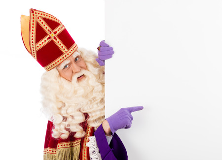 sinterklaas: Sinterklaas with placard  isolated  Stock Photo