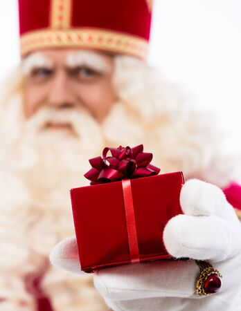 nicolaas: sinterklaas  with gift   typical Dutch character part of a traditional event celebrating the birthday of Sinterklaas  Santa Claus  in december Selective focus on gift