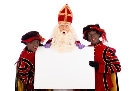 Sinterklaas en zwarte piet met aanplakbiljet. geïsoleerd op een witte achtergrond. Nederlandse karakter van de Kerstman Stockfoto - 28350917