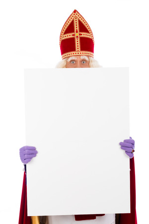 Sinterklaas holding  blank card. isolated on white background. Dutch character of Santa Claus 스톡 콘텐츠