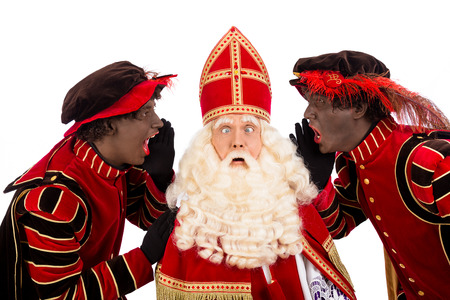 nicolaas: zwarte piet ( black pete)  and upset Sinterklaas . typical Dutch character part of a traditional event celebrating the birthday of Sinterklaas (Santa Claus) in december