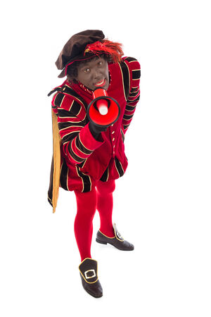 sint nicolaas: zwarte piet   black pete   with megaphone   typical Dutch character part of a traditional event celebrating the birthday of Sinterklaas  Santa Claus  in december Stock Photo