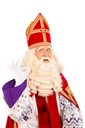 Sinterklaas met ok teken geïsoleerd op witte achtergrond Nederlandse karakter van de kerstman Stockfoto