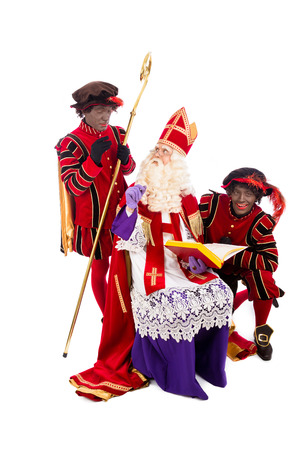 pieten: Sinterklaas with book  isolated on white background  Dutch character of Santa Claus Stock Photo