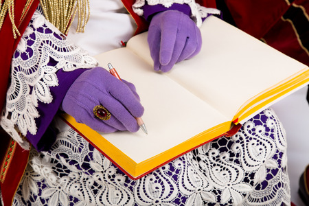 nicolaas: Sinterklaas with book Detail  Dutch character of Santa Claus Stock Photo