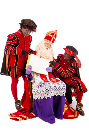 saint nicolaas: Sinterklaas with book  isolated on white background  Dutch character of Santa Claus Stock Photo