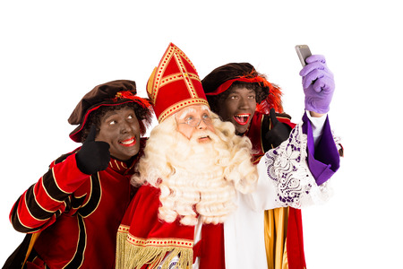 black pete: Sinterklaas and Zwarte Piet making selfie  isolated on white background  Dutch character of Santa Claus Stock Photo