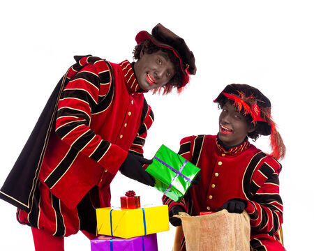 'black pete': zwarte piet   black pete   with gift   typical Dutch character part of a traditional event celebrating the birthday of Sinterklaas  Santa Claus  in december