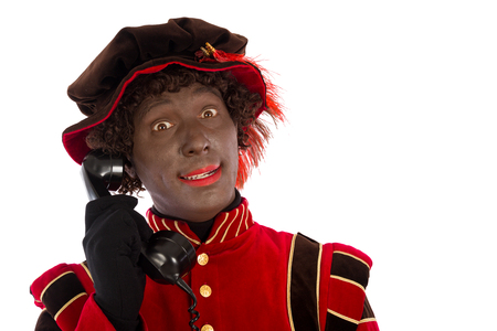 zwarte piet: zwarte Piet  with old vintage telephone  isolated on white background  Dutch character of Santa Claus Stock Photo