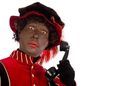 sint nicolaas: Black pete with old vintage telephone  isolated on white background  Dutch character of Santa Claus