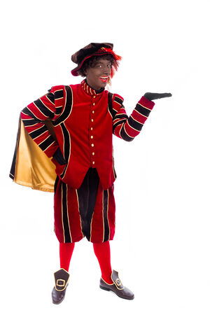 zwarte piet   black pete   with gift   typical Dutch character part of a traditional event celebrating the birthday of Sinterklaas  Santa Claus  in december photo