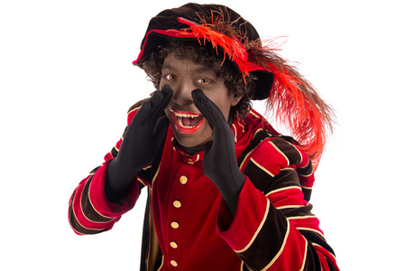 zwarte piet ( black pete) shouting . typical Dutch character part of a traditional event celebrating the birthday of Sinterklaas (Santa Claus) in december