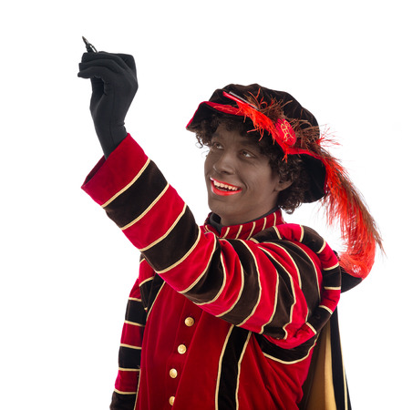 Zwarte Piet ( black pete)  writing on whiteboard. typical Dutch character part of a traditional event celebrating the birthday of Sinterklaas in december