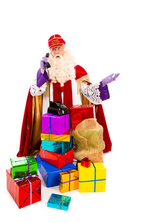 pieten: Sinterklaas with presents and old vintage telephone. isolated on white background. Dutch character of Santa Claus Stock Photo