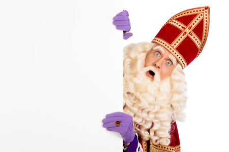 nicolaas: Sinterklaas with blank paper. isolated on white background. Dutch character of Santa Claus