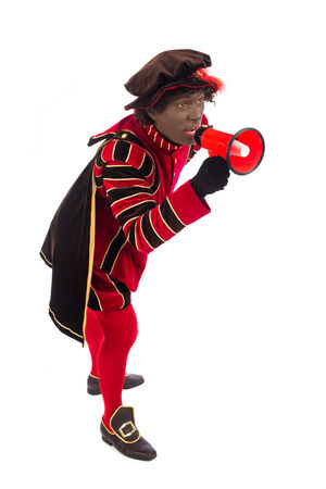 zwarte piet: zwarte piet ( black pete)  with megaphone . typical Dutch character part of a traditional event celebrating the birthday of Sinterklaas (Santa Claus) in december Stock Photo