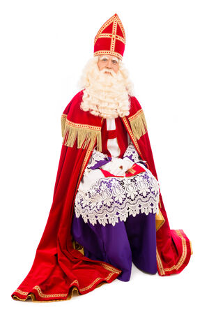 nicolaas: Sitting Sinterklaas . isolated on white background. Dutch character of Santa Claus Stock Photo