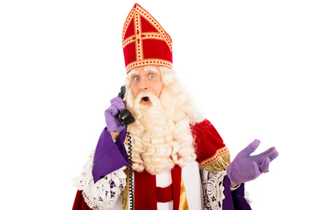 Sinterklaas with presents and old vintage telephone. isolated on white background. Dutch character of Santa Claus photo