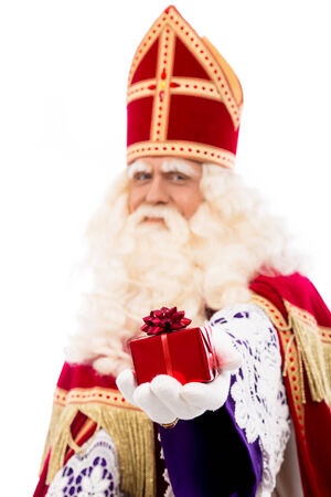 nicolaas: sinterklaas  with gift . typical Dutch character part of a traditional event celebrating the birthday of Sinterklaas (Santa Claus) in december.Selective focus on gift