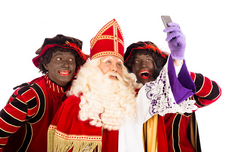 nicolaas: Sinterklaas and Zwarte Piet making selfie. isolated on white background. Dutch character of Santa Claus Stock Photo
