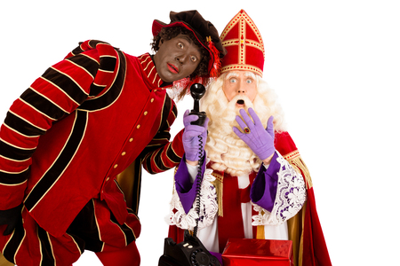zwarte piet: Sinterklaas and Zwarte Piet with old vintage telephone. isolated on white background. Dutch character of Santa Claus Stock Photo
