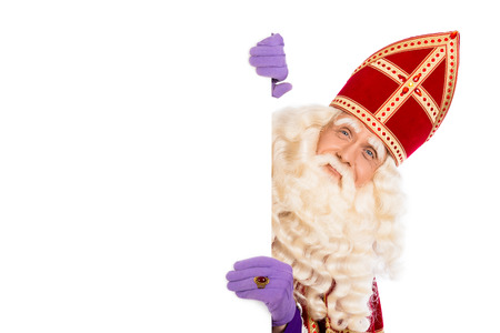 Smiling Sinterklaas with white board. isolated on white background. Dutch character of Santa Claus 스톡 콘텐츠