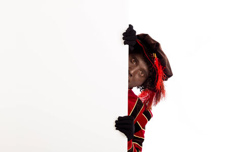 Zwarte Piet ( black pete)  with whiteboard. typical Dutch character part of a traditional event celebrating the birthday of Sinterklaas in december