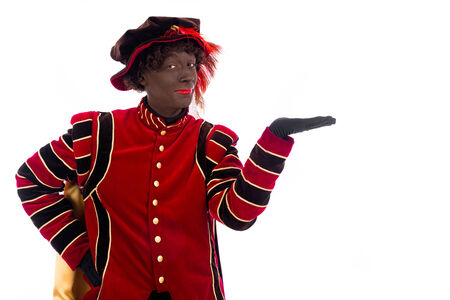 zwarte piet ( black pete)  with gift . typical Dutch character part of a traditional event celebrating the birthday of Sinterklaas (Santa Claus) in december
