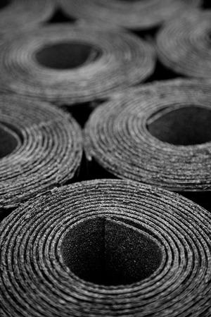 damp proofing: Closeup of Rolls of new black roofing felt or bitumen
