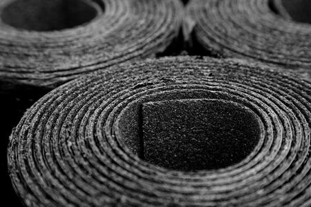Closeup of Rolls of new black roofing felt or bitumen