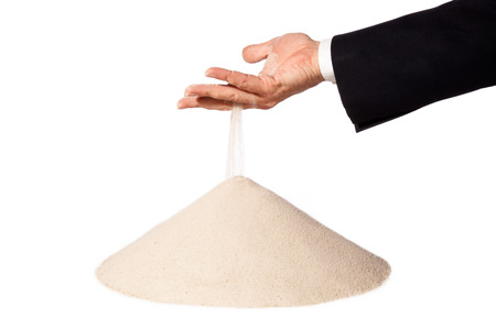 sand running through hand of a businessman as a symbol for time running out.Isolated on a white background