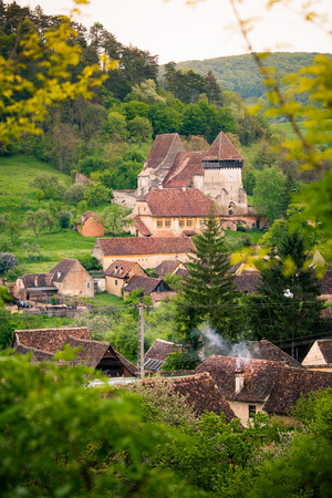 biertan: Street view of medieval Saxon village of copsa mare with fortified church  in Romania .In Transylvania region
