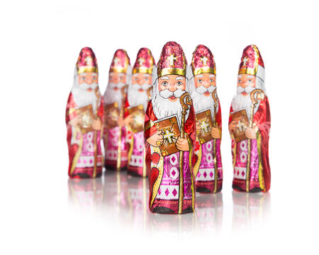 Close up of Sinterklaas. Saint  Nicholas chocolate figure of  Dutch character of Santa Claus.Isolated on white background. photo