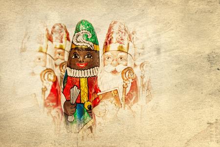 sint nicolaas: Close up of Sinterklaas and Black Pete on old paper . Saint  Nicholas chocolate figure of  Dutch character of Santa Claus