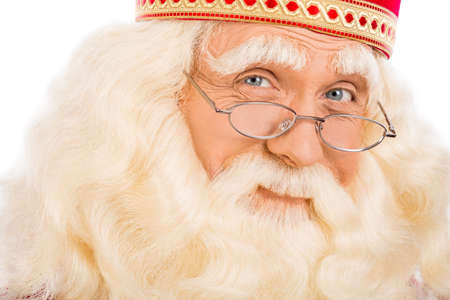 nicolaas: Photo of Santa Claus  on white background and looking at camera.