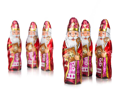 zwarte: Close up of Sinterklaas. Saint  Nicholas chocolate figure of  Dutch character of Santa Claus.Isolated on white background.