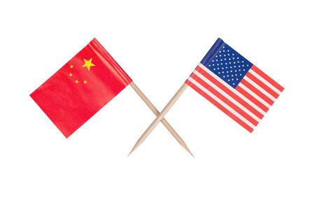 Crossed mini flag USA and China. Isolated on white background photo