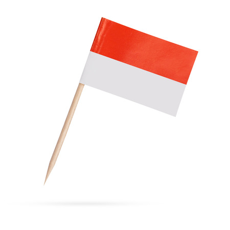 indonesia culture: Miniature paper flag Indonesia. Isolated Indonesian Flag on white background.With shadow below