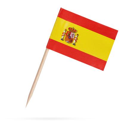 Miniatuur papier vlag Spanje. Geïsoleerde Spaanse vlag op wit background.With schaduw hieronder Stockfoto