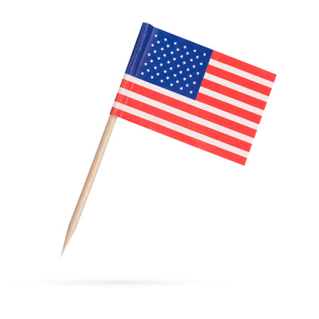 Miniature paper flag USA. Isolated American Flag on white background. With shadow below Foto de archivo