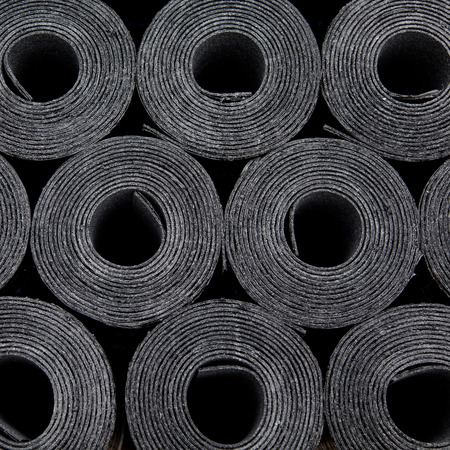 Rolls of new black roof coating or bitumen