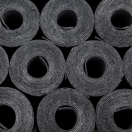 tar felt: Rolls of new black roof coating or bitumen