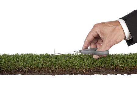 Zakenman is de voorbereiding van de green. Metafoor voor service en perfectie. Met een kopie ruimte Stockfoto