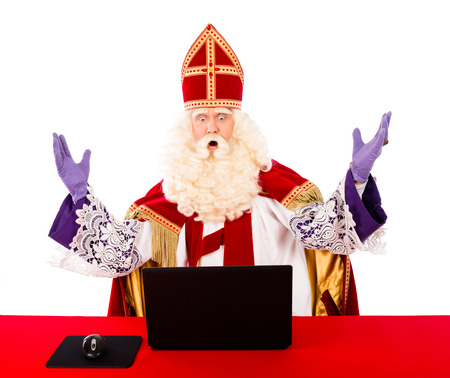 black pete: Sinterklaas with laptop. isolated on white background. Dutch character of Santa Claus