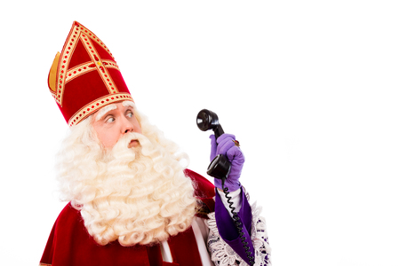 black pete: Sinterklaas with old vintage telephone. isolated on white background. Dutch character of Santa Claus