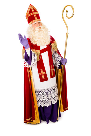 miter: Sinterklaas waving portrait full length . isolated on white background. Dutch character of Santa Claus